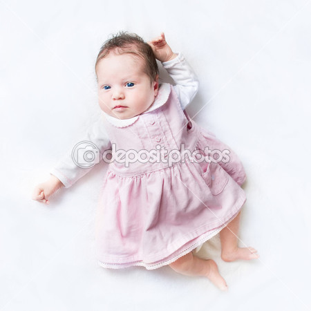 depositphotos_43247169-Baby-girl-wearing-her-first-dress